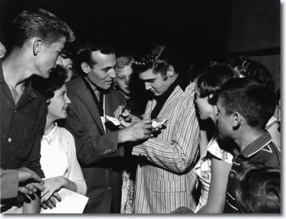 Carl Perkins and Elvis Presley sign autographs at Overton Park Shell on the night of June 1, 1956.