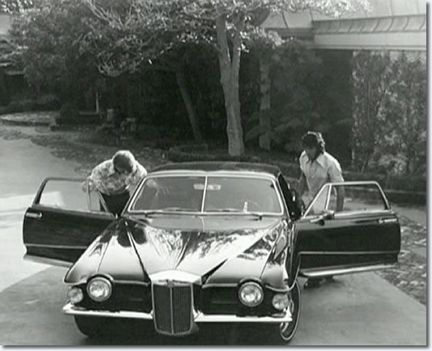 Elvis with his 1971 Stutz Blackhawk production model - 144 Monavale Street, Beverly Hills - September, 1971
