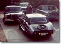 Elvis leaving 1174 Hillcrest Drive home (See rear reverse lamps!) - Click to view larger image.