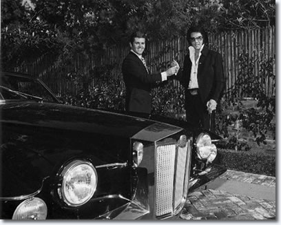 Elvis takes delivery of his 1971 Stutz Blackhawk from Jules Meyers 1971