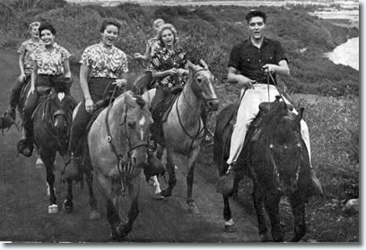 Elvis Presley and cast in Blue Hawaii