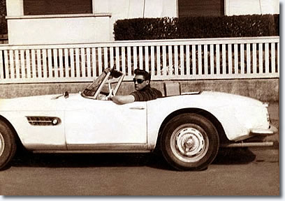 Elvis in his white BMW 507 in front Goethestraße 14, in Bad Nauheim - June 1959