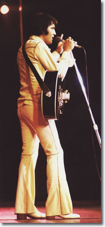 Elvis wearing the cream leather suit.