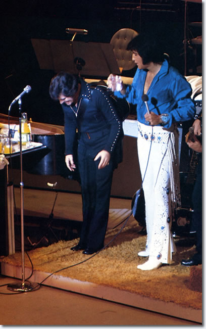 Charlie Hodge and Elvis Presley on stage