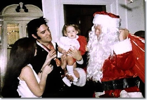 Elvis Presley with Priscilla, Lisa Marie and Vernon (Santa) Presley