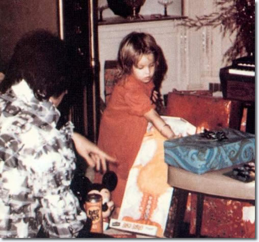 Elvis at Christmas. Elvis with Lisa Marie, perhaps the one and only true love of his life