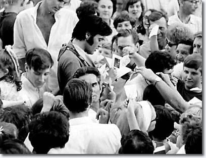 Elvis Presley at the gates of Graceland