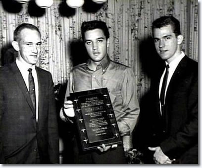 Elvis Presley poses with his new fraternity brothers in front of Graceland