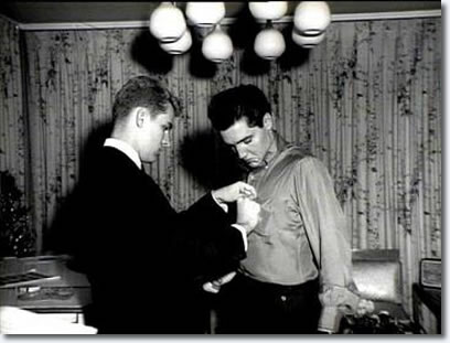 Rick Husky pins a TKE pledge pin on his newest fraternity brother Elvis Presley