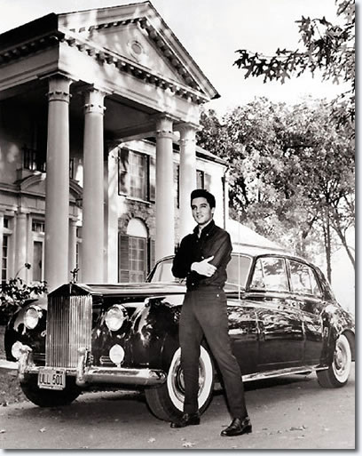 Elvis with his Rolls Royce in front of Graceland