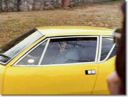 Elvis driving his De Tomaso Pantera