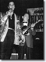 Hank Garland, right, performs with Elvis Presley.