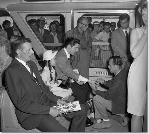 Elvis Presley receives a manicure on Seattle's Monorail. Presley was filming 'It Happened at the Fair' during Seattle's 1962 World's Fair. Washington, USA.
