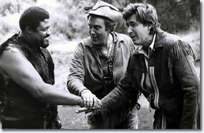Rosie Grier Jimmy Dean and Fess Parker on the set of the Daniel Boone Show.