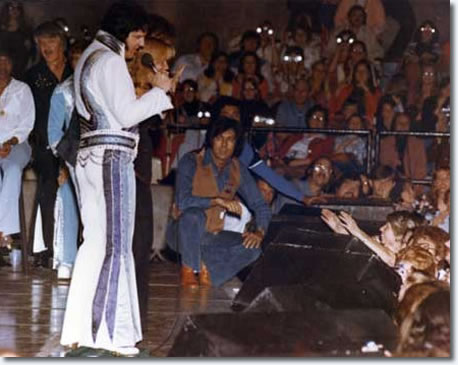 Larry Geller with Elvis on stage, Florida, 1976.