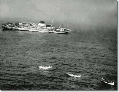 The luxury Italian liner Andrea Doria, listing heavily starboard in the final moments of her death throes