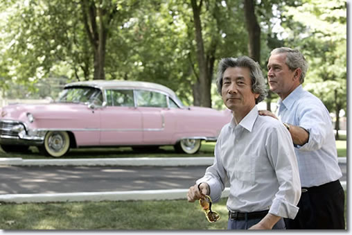 President Bush and Japanese Prime Minister Junichiro Koizumi walk past Elvis' pink Cadillac after their tour of Graceland, the home of Elvis Presley, in Memphis, Tennessee