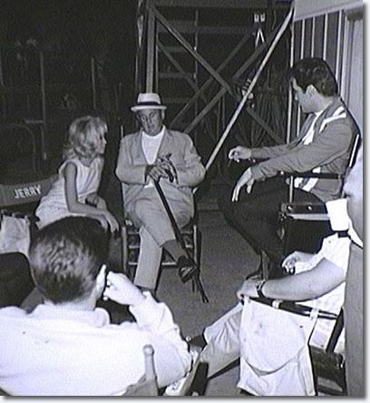 Between scenes on the set of Speedway with Elvis, Nancy Sinatra, the Colonel