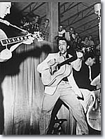 Tampa photographer William V. (Red) Robertson is believed to have taken this photo of Elvis at Tampa's Fort Homer Hesterly Armory on July 31, 1955.