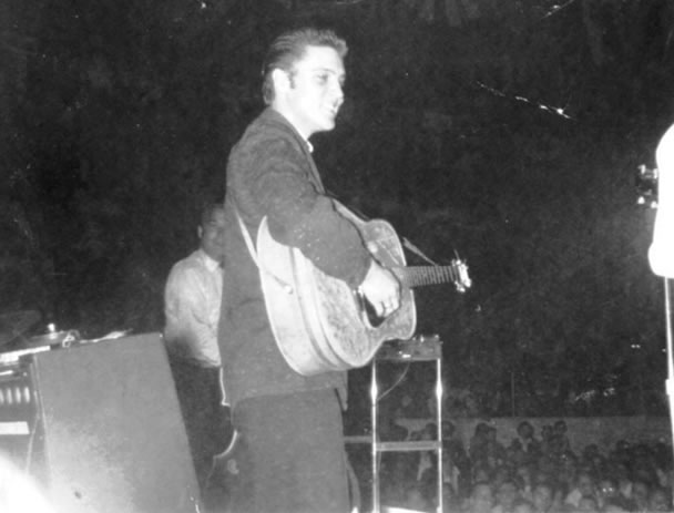 Elvis Presley is shown during his performance at the Tulsa fairgrounds Pavilion in 1956.