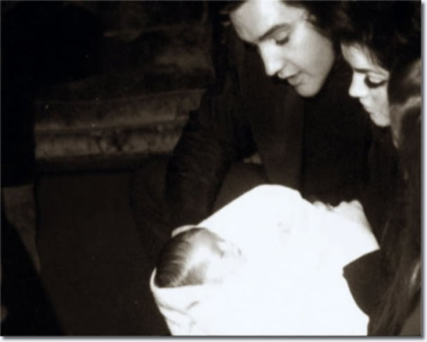 Elvis, Prescilla and Lisa Marie Presley.