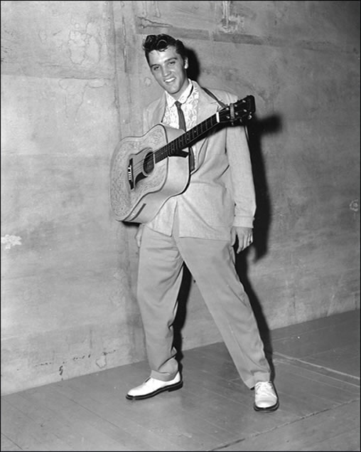 Elvis hangs out backstage at the Overton Park Shell on August 5, 1955.