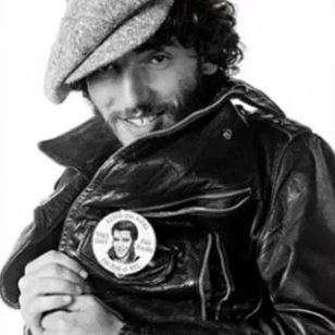 Bruce Springsteen proudly displays an Elvis Presley fan club badge in a photo taken by Eric Meola. This outtake from the photo session for the 'Born to Run' album cover is seen in Dennis P. Laverty's new documentary, 'If I Can Dream: The Influence of Elvis on Bruce'.
