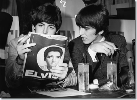 Paul McCartney and George Harrison read a magazine article about Elvis Presley.