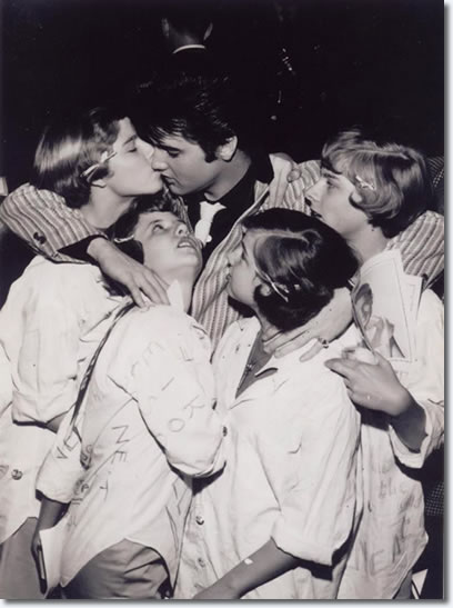 Elvis Presley with fans.