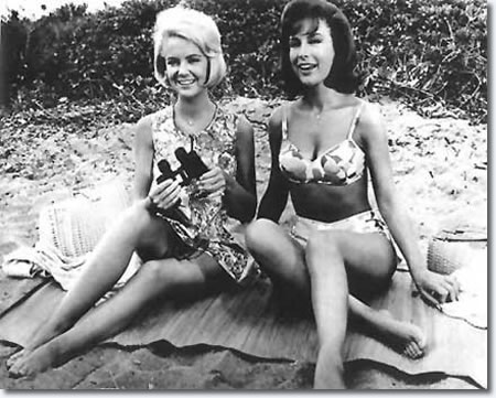 Shelly Fabares and Barbara Eden on a beach blanket together in 1964.