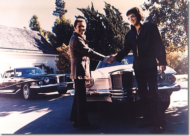 Elvis Presley accepting keys for his 1972 Pearl White Stutz Blackhawk from Jules Meyers in late September / early October 1973