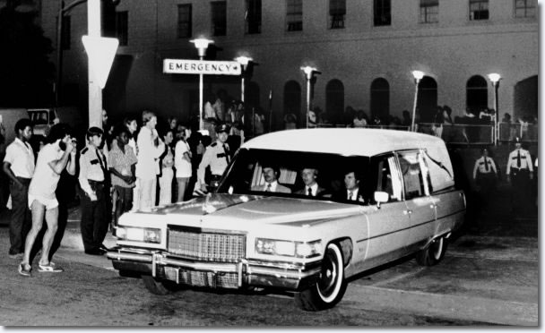 People wait near the emergency entrance of Baptist Memorial Hospital as the hearse carrying the body of Elvis Presley leaves the hospital Aug. 16, 1977