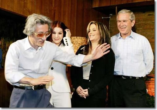 Japanese Prime Minister Junichiro Koizumi does an Elvis Presley impression. With Priscilla Presley & Lisa Marie Presley and George Bush - Graceland, Memphis, Tennessee