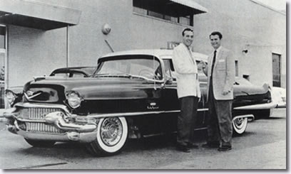 Sam Phillips presents Carl Perkins with a new Cadillac