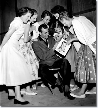 Carl Perkins signs autographs at Overton Park Shell on the night of June 1, 1956.