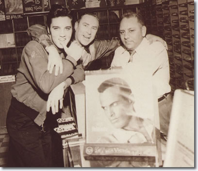 Dewey Phillips & Elvis Presley at 'Pop Tunes' music store