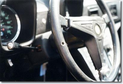 Elvis' 1971 yellow De Tomaso Pantera - With bullet hole in steering wheel.