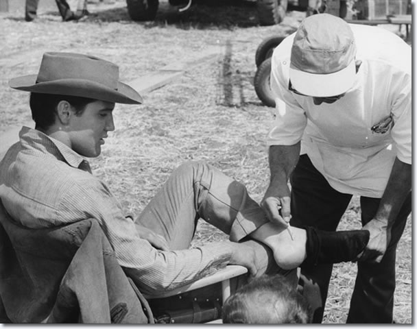 Elvis has a cut on his ankle attended to, on the set of Flaming Star