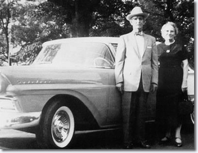 J.D. and Vera Presley with the car Elvis gave them