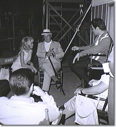 Between scenes on the set of Speedway with Elvis, Nancy Sinatra, the Colonel