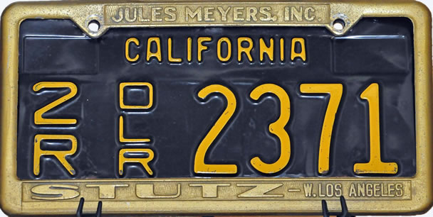 T he license plate and frame used to transport Elvis' car to the car show.
