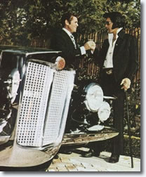 Jules Meyers hands Elvis the keys to his Stutz Blackhawk - 1971