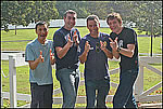 The Wiggles (Jeff, Greg, Anthony and Murray) at the pasture fence in Graceland's backyard.