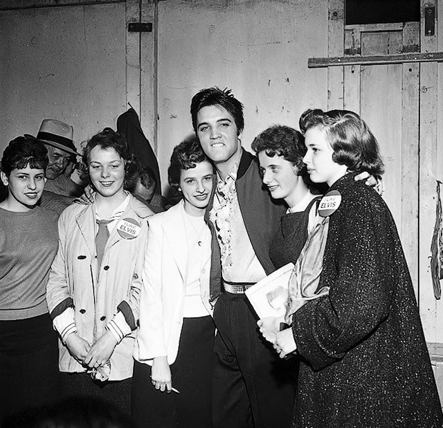 Elvis Presley with fans backstage in Buffalo, April 1, 1957, from the York University Libraries, Clara Thomas Archives & Special Collections, Toronto Telegram fonds, F0433, ASC00837.