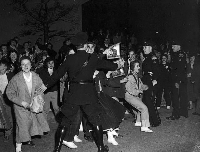 Elvis Presley's fans and Toronto Police, April 2, 1957, from the York University Libraries, Clara Thomas Archives & Special Collections, Toronto Telegram fonds, F0433, ASC07058.