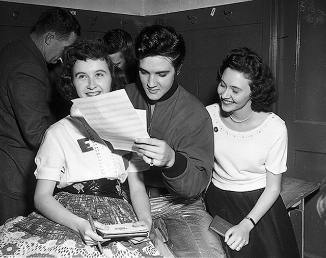 Elvis Presley with fans backstage, April 2, 1957, from the York University Libraries, Clara Thomas Archives & Special Collections, Toronto Telegram fonds, F0433, ASC00836.