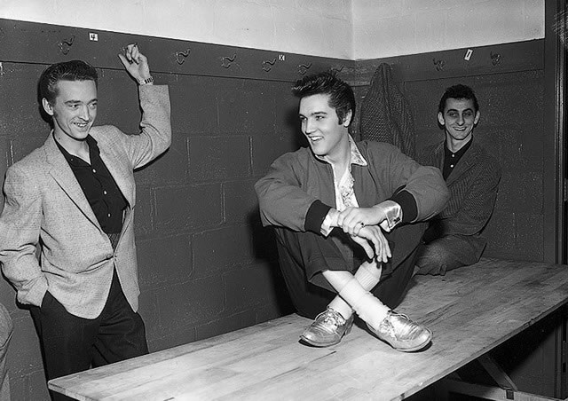 Elvis Presley backstage at Maple Leaf Gardens with Gene Smith (L) and George Klein (R), April 2, 1957, from the York University Libraries, Clara Thomas Archives & Special Collections, Toronto Telegram fonds, F0433, ASC00833.