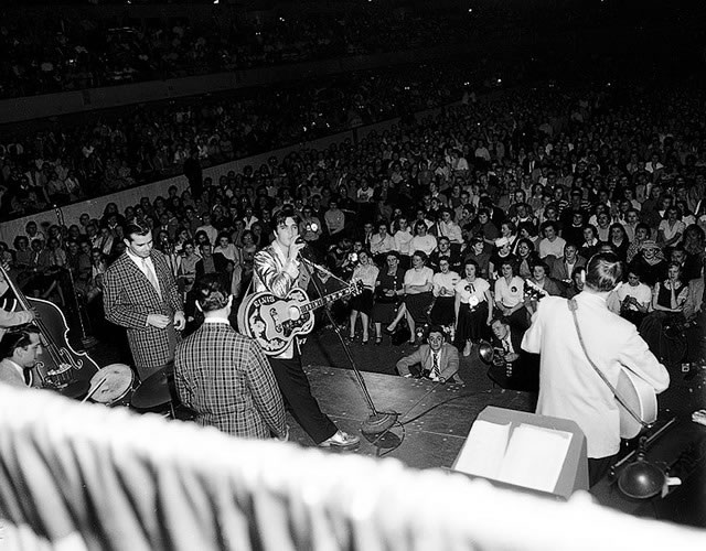 Elvis Presley on stage during a show the previous night in Buffalo, from the York University Libraries, Clara Thomas Archives & Special Collections, Toronto Telegram fonds, F0433, ASC00835.