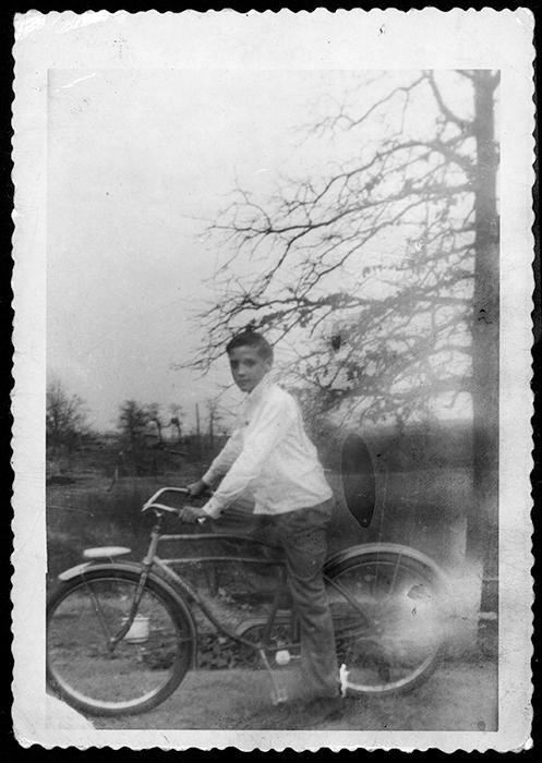 Elvis on his new bike in Tupelo around January, 1948.