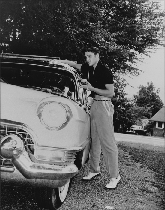 Elvis shines up his cadillac at his Getwell home.